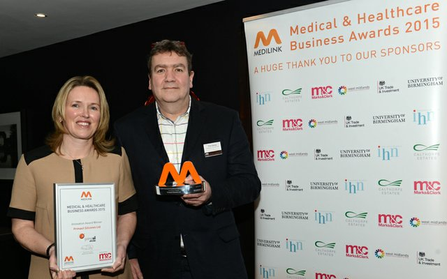 Caroline Herdman & Clive Denley receive the Medilink award from the Primasil project team.jpg