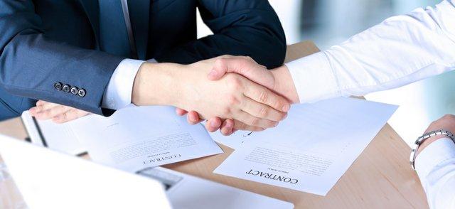 Handshake over contract.jpg